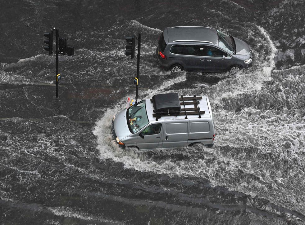 <p>A flooded road in Nine Elms , London, on Suunday after extreme heat triggered torrential rain</p>