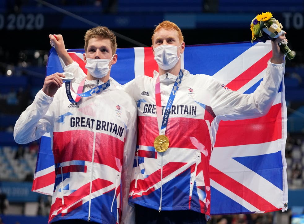 <p>Duncan Scott and Tom Dean celebrate their medals</p>