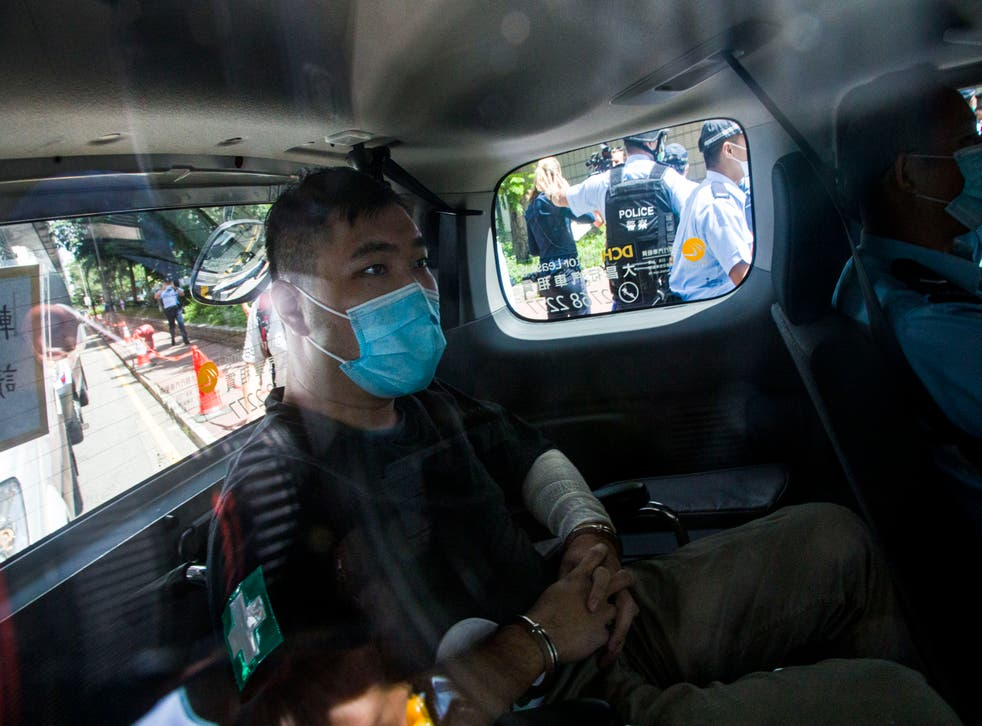 <p>File: Hong Kong defendant Tong Ying-Kit, 24, arrives at court after being accused of deliberately driving his motorcycle into a group of police officers last Wednesday on 6 July, 2020</p>