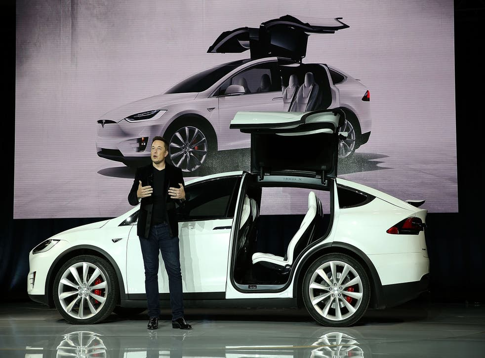 <p>Tesla CEO Elon Musk speaks during an event to launch the new Tesla Model X Crossover SUV </p>