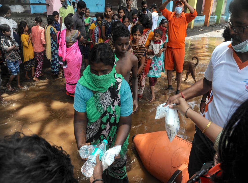 <p>India's National Disaster Response Force (NDRF) personnel distribute food and relief material to people impacted by floods in Maharashtra </p>