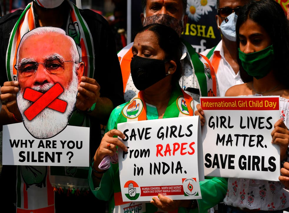 <p>File: Political activists hold placards and a cut-out of India's prime minister Narendra Modi during a protest condemning the alleged gang-rape and murder of a teenaged woman at Hathras in Uttar Pradesh state</p>