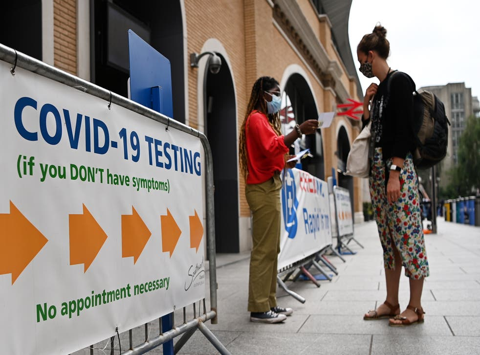 <p>A COVID testing centre in London. Vaccinated people who are sneezing can order a test through the ZOE app.</p>