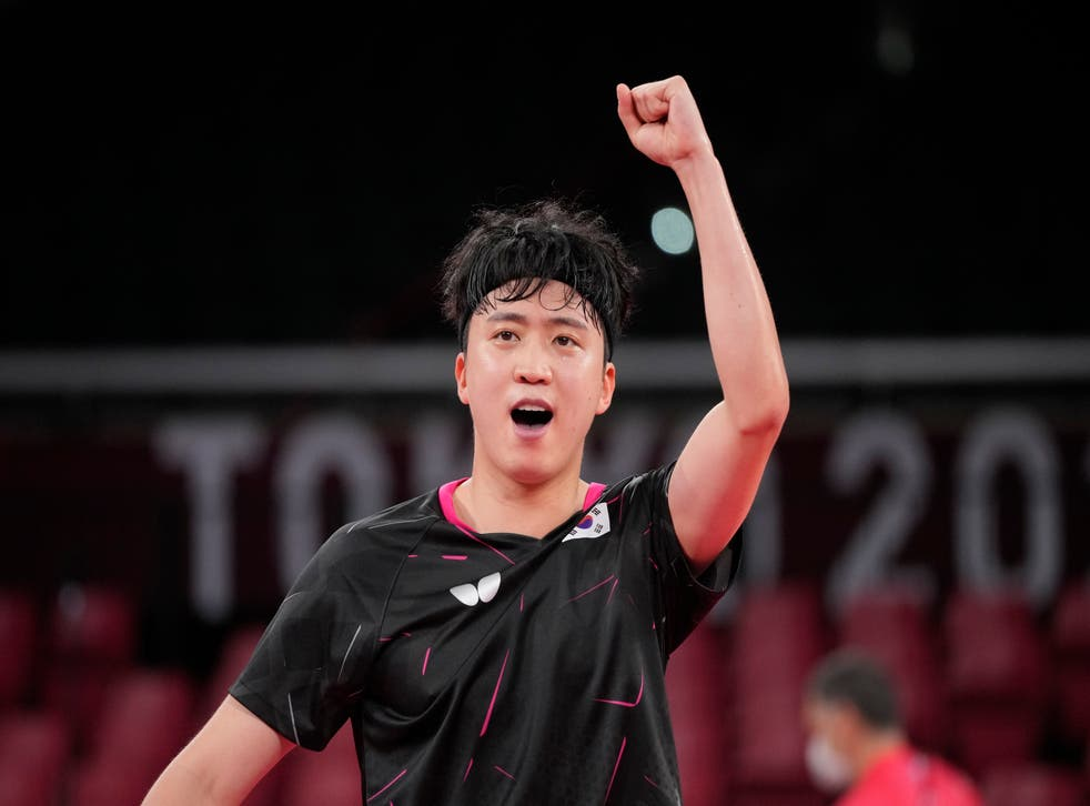 <p>Jeoung Young-sik celebrates after defeating Greek player Panagiotis Gionis in Round 3 of the men's table tennis singles competition</p>