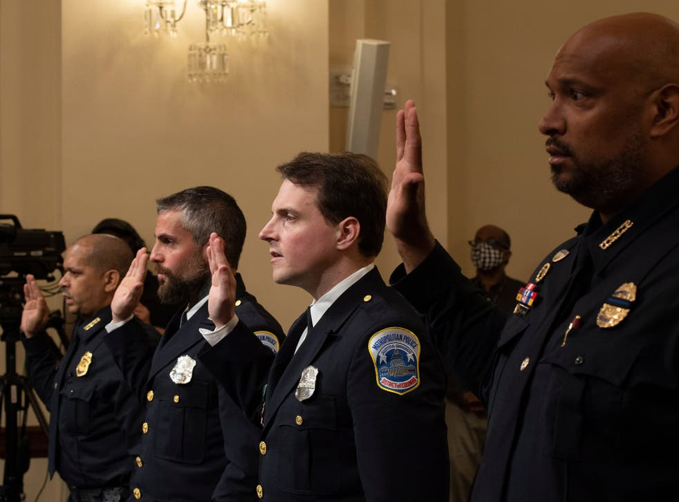 <p>Four officers with the US Capitol Police are sworn in at Tuesday's hearing on the 6 January attack.</p>