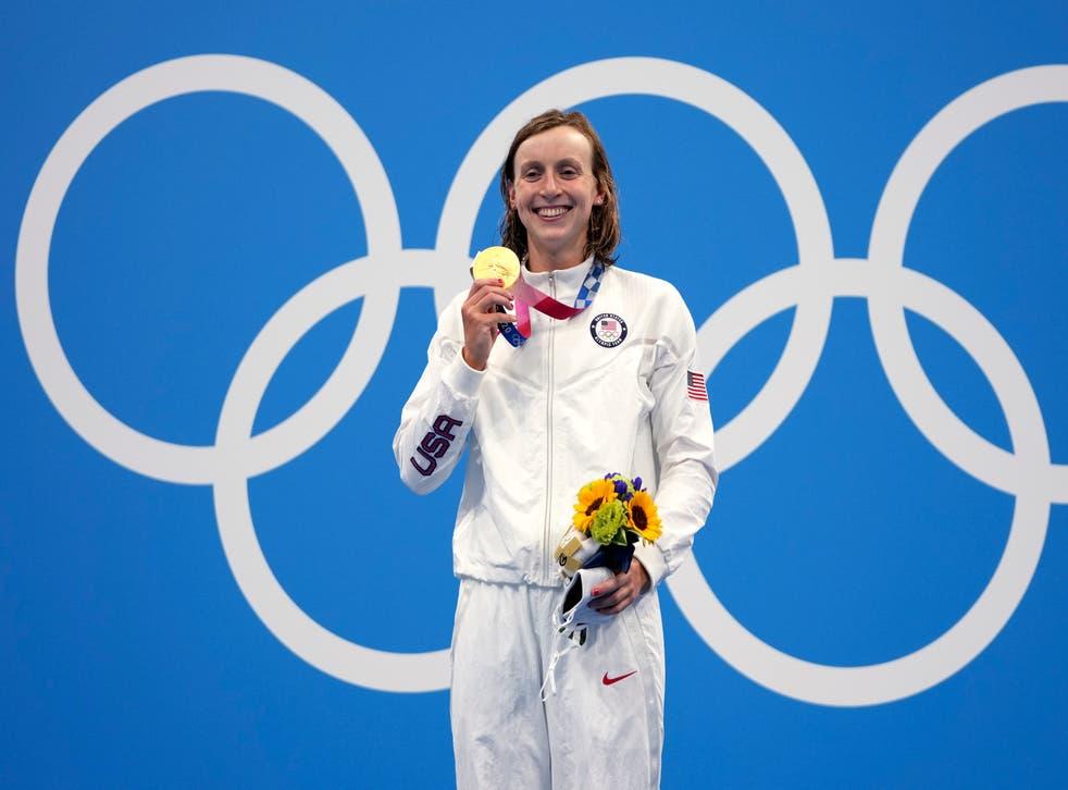 <p>Katie Ledecky celebrates winning 1500m gold</p>
