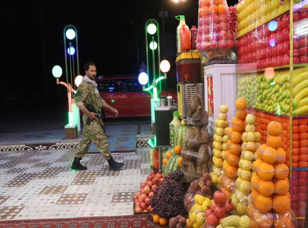 <p>An Afghan security official patrols after Afghan authorities imposed a night curfew in 31 of the 34 provinces in Afghanistan, in Herat, Afghanistan, 28 July 2021</p>
