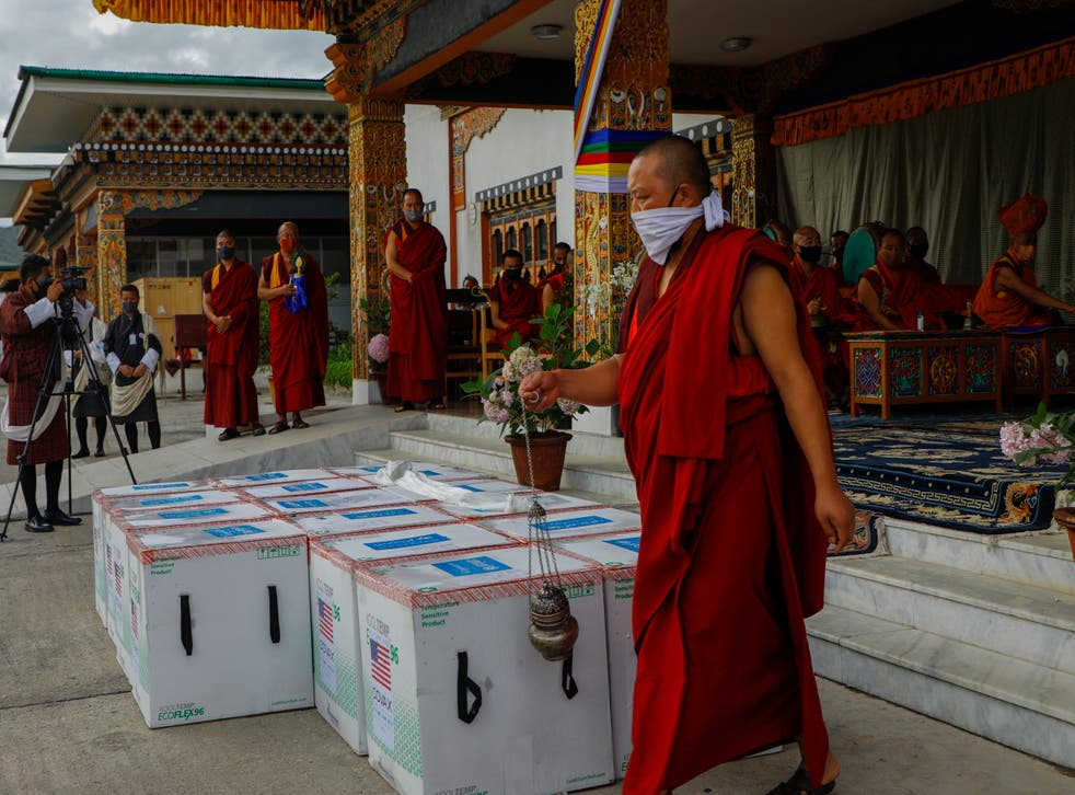 <p>This photograph provided by Unicef shows monks from Paro's monastic body performing a ritual as 500,000 doses of Moderna vaccine gifted from the United States arrive at Paro International </p>