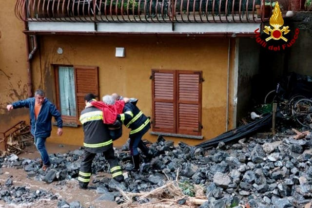 <p>An elderly woman rescued by firefighters from her home </p>
