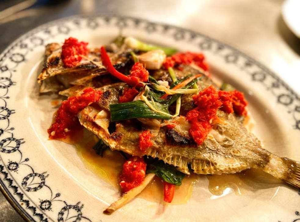 <p>Whole grilled John Dory served Thai-style, in as un-Thai a setting as you can imagine</p>
