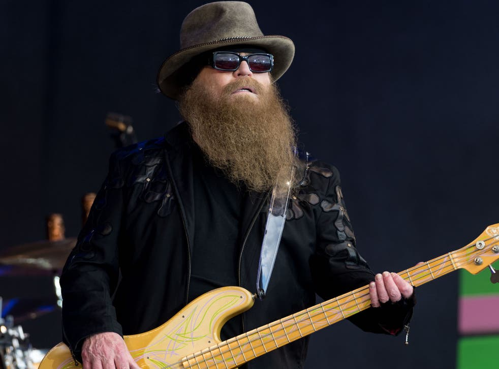 <p>Dusty Hill performs on the Pyramid Stage during the 2016 Glastonbury Festival</p>