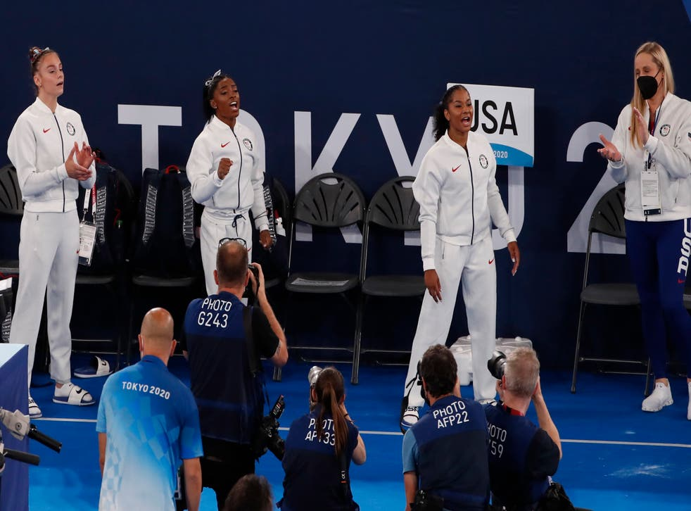 <p>Athletes from the USA support their teammate Simon Biles during the Artistic Gymnastics Women Final of the Tokyo 2020 Olympic Games at the Ariake? Gymnastics Centre in Tokyo, Japan, 27 July 2021</p>