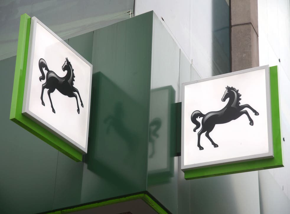 Lloyds Banking Group has revealed it swung to a £3.9bn half-year profit from a £602m loss a year ago as it cut bad debt provisions thanks to the UK's economic recovery (Yui Mok/PA)