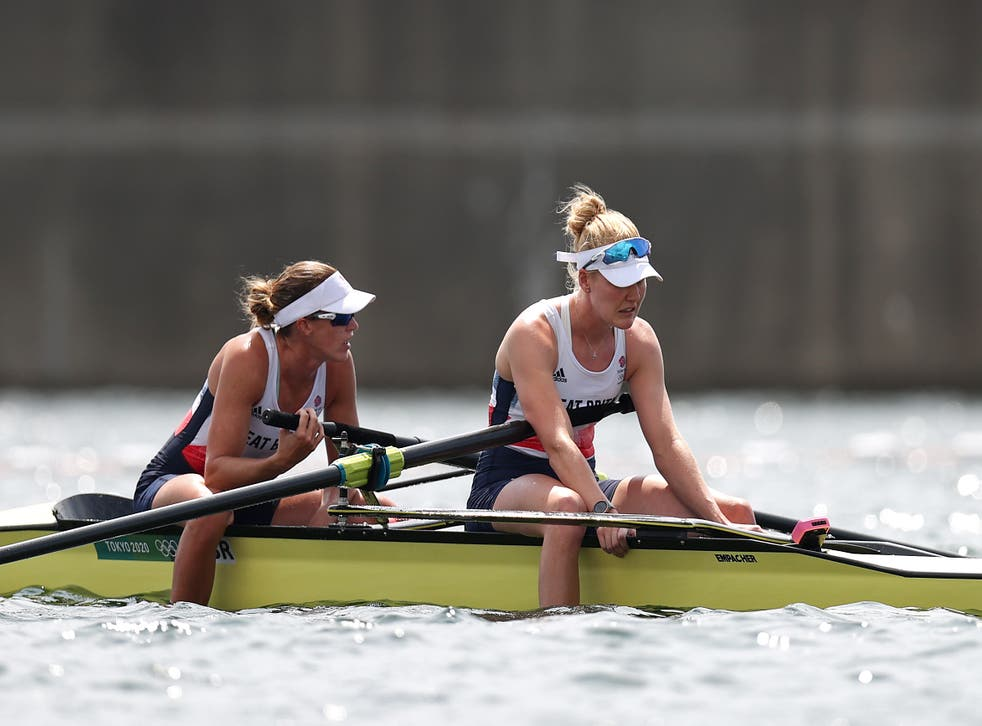 <p>Helen Glover (left) and Polly Swann of Team GB react after coming in fourth in the women's pair final</p>