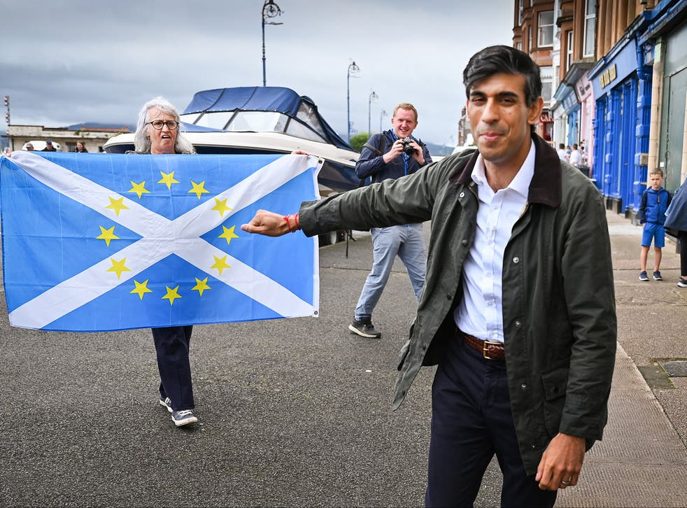 In this file photo from 2020, Sunak is greeted by nationalist demonstrators during a visit to the Isle of Bute