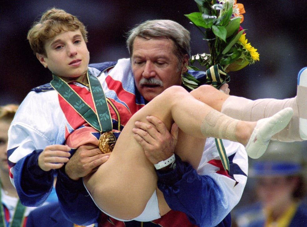 <p>File: Kerri Strug being carried off the floor by her coach Bela Karolyi after her performance at the 1996 Olympic Games in Atlanta, Georgia</p>