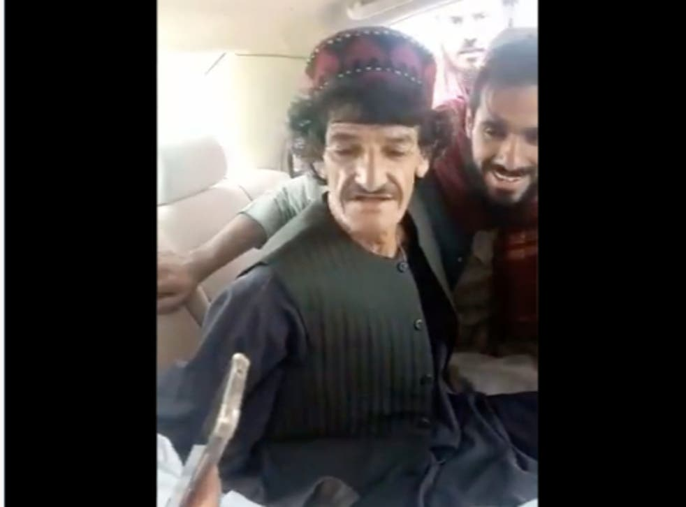 <p>A screengrab from the video that shows comic  Nazar Mohammad, better known as Khasha Zwan getting thrashed by Taliban men</p>