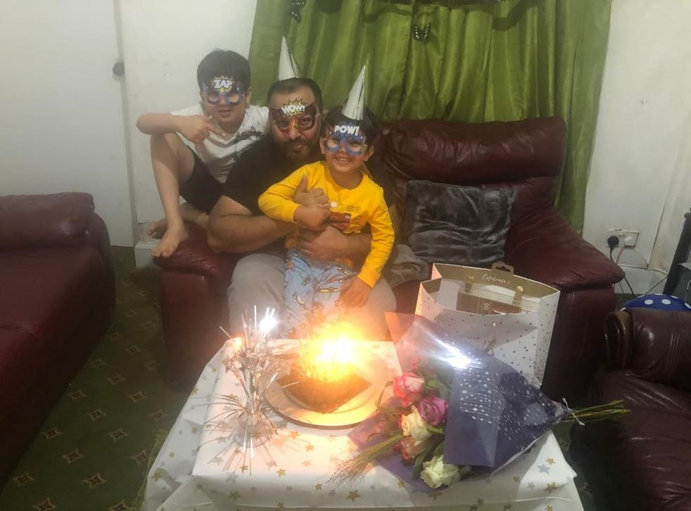<p>Asim Riaz and his two sons celebrate a birthday just weeks before their tragic trip to Loch Lomond</p>
