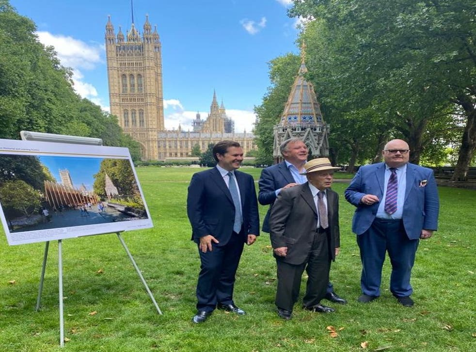 <p>MP Robert Jenrick with holocaust survivors outside Houses of Parliament in Westminster on July 29. </p>
