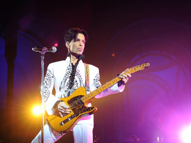 <p>Prince performing in 2011</p>