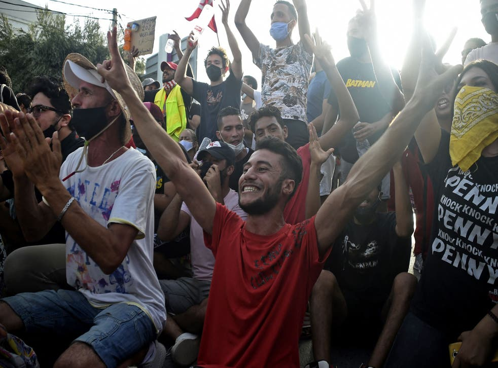 <p>Supporters cheer outside parliament in Tunis after the president dismissed the prime minister </p>