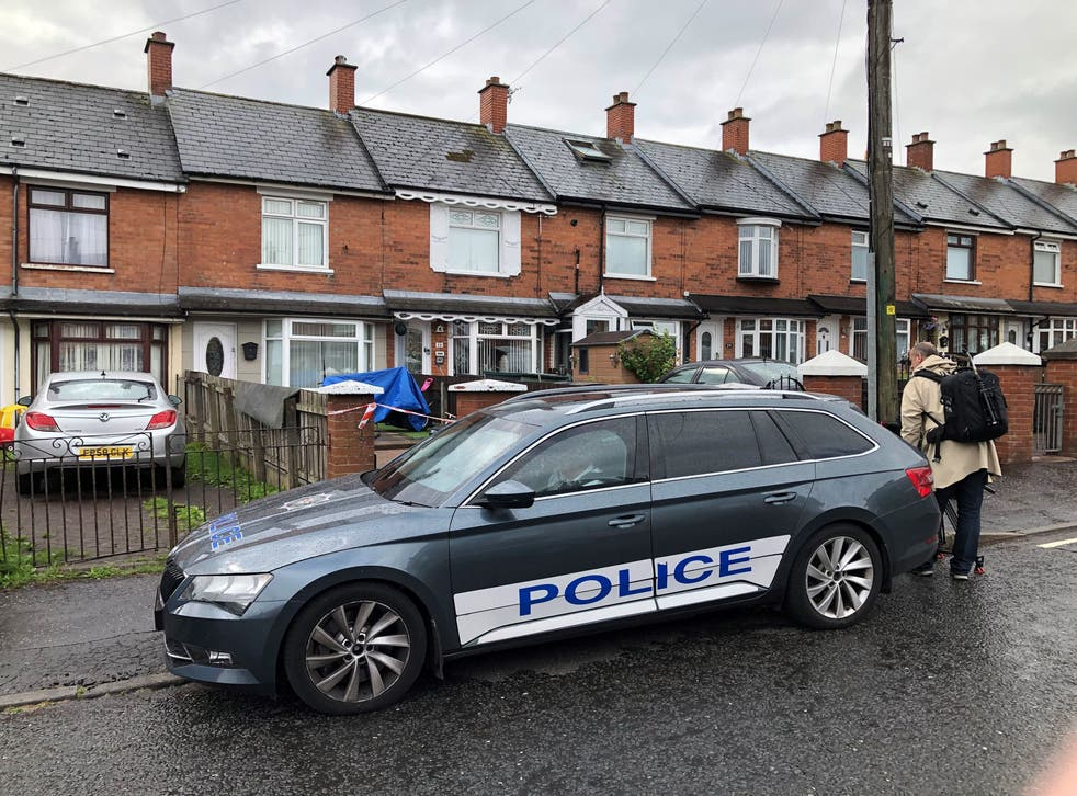 <p>Police at the scene in Brompton Park, Belfast, where a baby died and another young child was critically injured</p>
