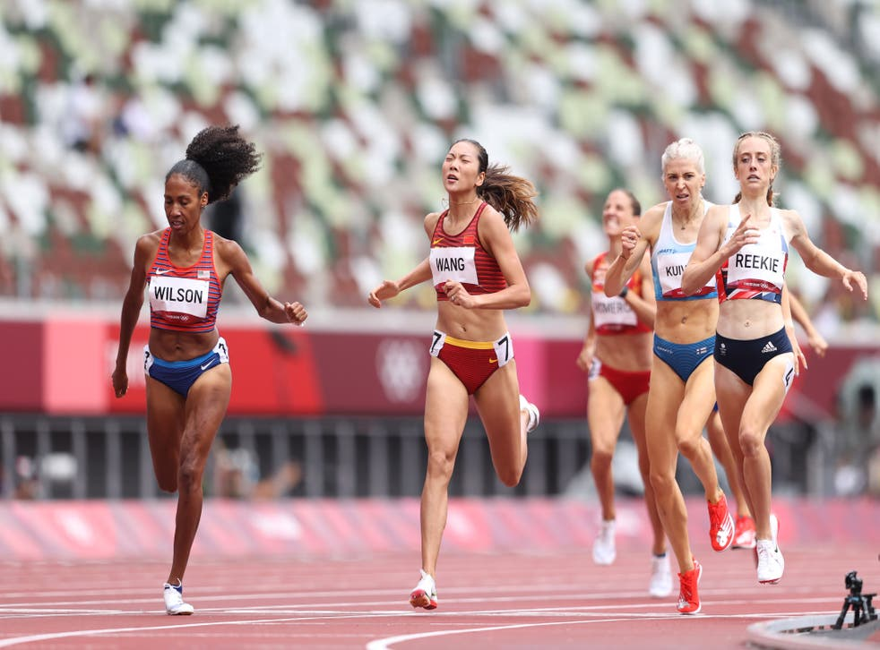 <p>File: Ajee Wilson of Team United States and Chunyu Wang of Team China compete during the Women's 800m heats  at the Tokyo 2020 Olympic Games</p>