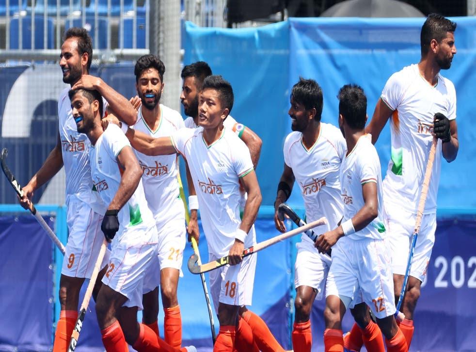 <p>Varun Kumar of India celebrates with teammates after scoring against Argentina</p>