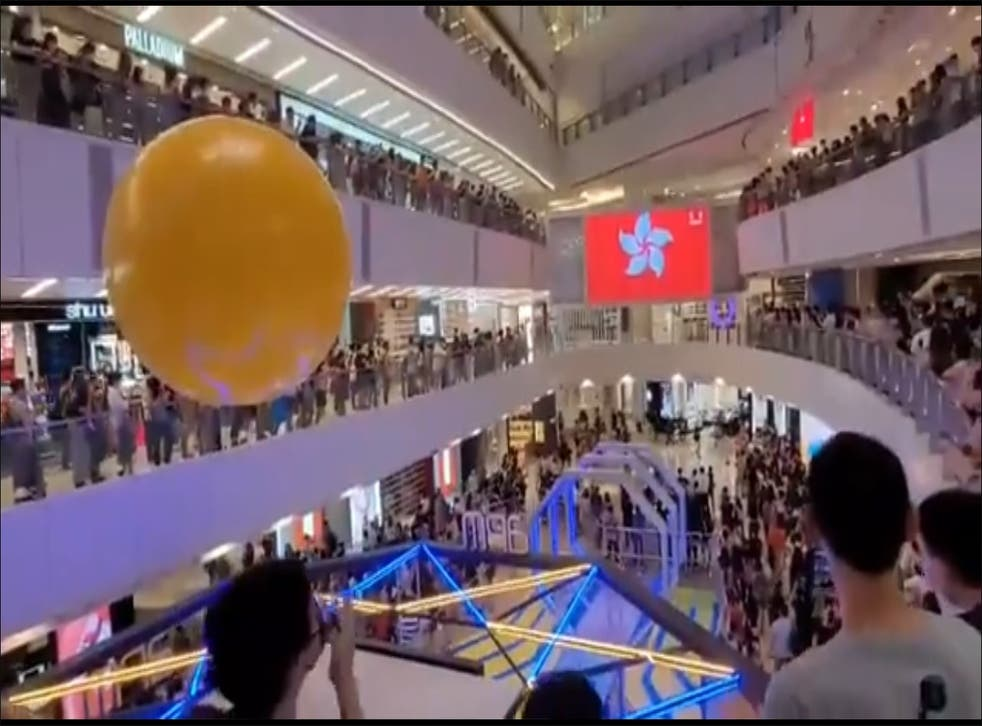 <p>Crowd at Hong Kong mall boo Chinese national anthem during a broadcast of the medal ceremony as a Hong Kong fencer was awarded</p>