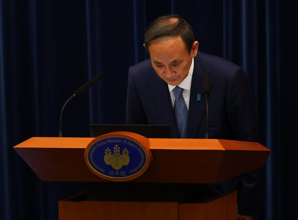 <p>Japan's prime minister Yoshihide Suga bows as he attends a news conference on Japan's response to the coronavirus pandemic</p>