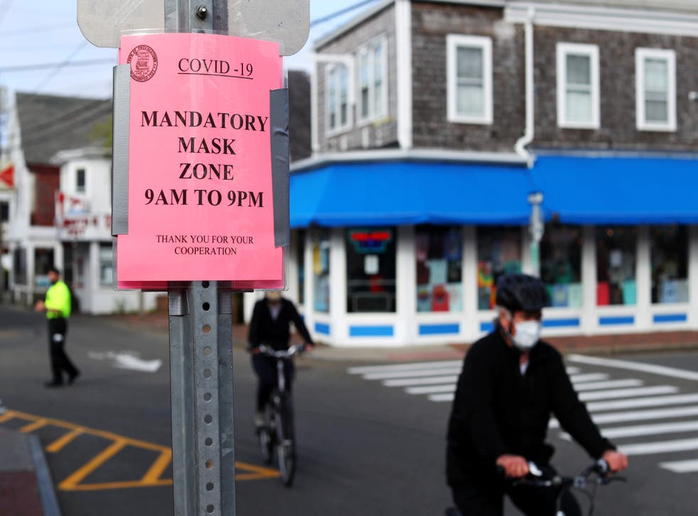 <p>People bike down Commercial Street on May 25, 2020 in Provincetown, Massachusetts</p>