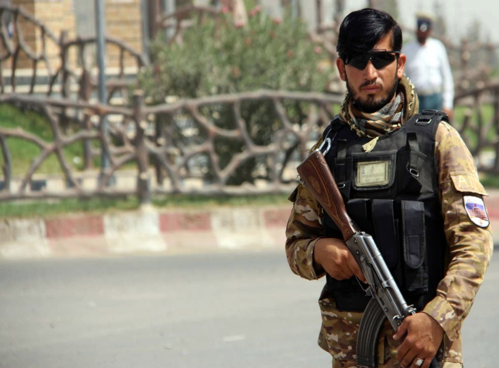 <p>An Afghan check point in Lashkar Gah, which could fall to the Taliban</p>