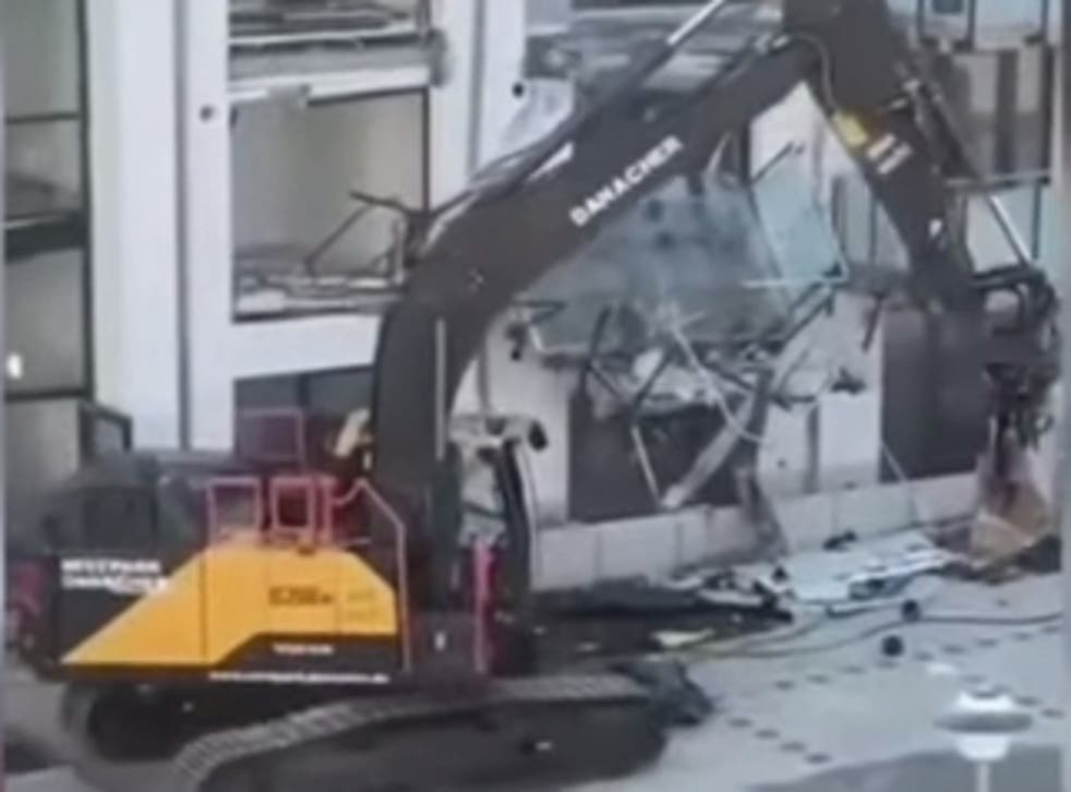 <p>A man has destroyed a new appartment build with a digger</p>