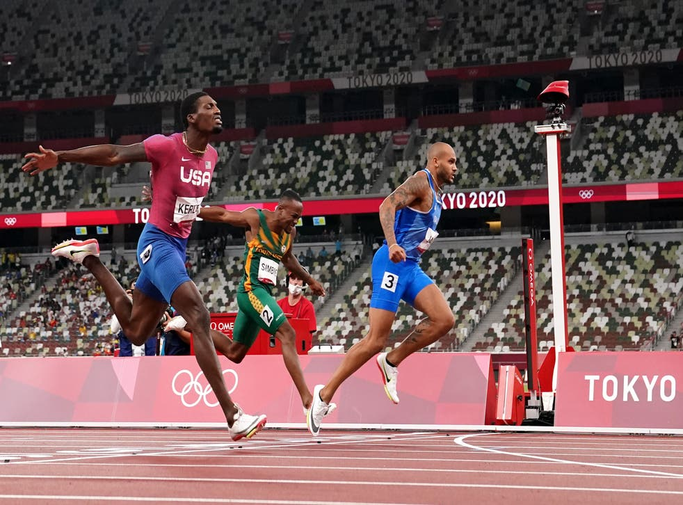<p>Italian speeds across the finish line to take gold</p>