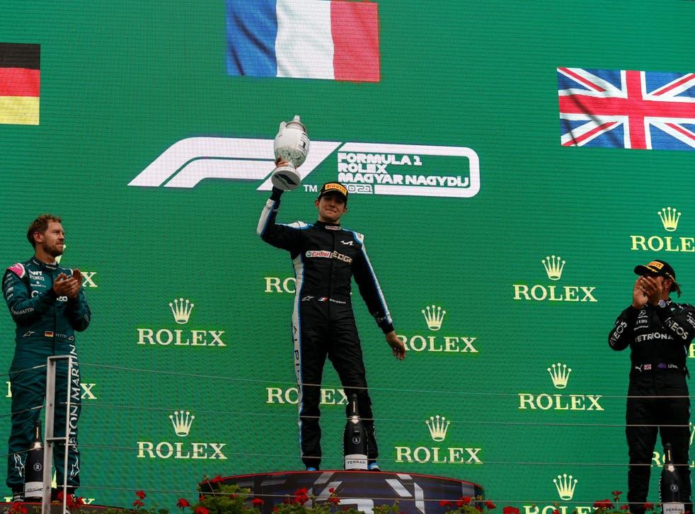 <p>Esteban Ocon celebrates after beating Sebastian Vettel and Lewis Hamilton to victory</p>