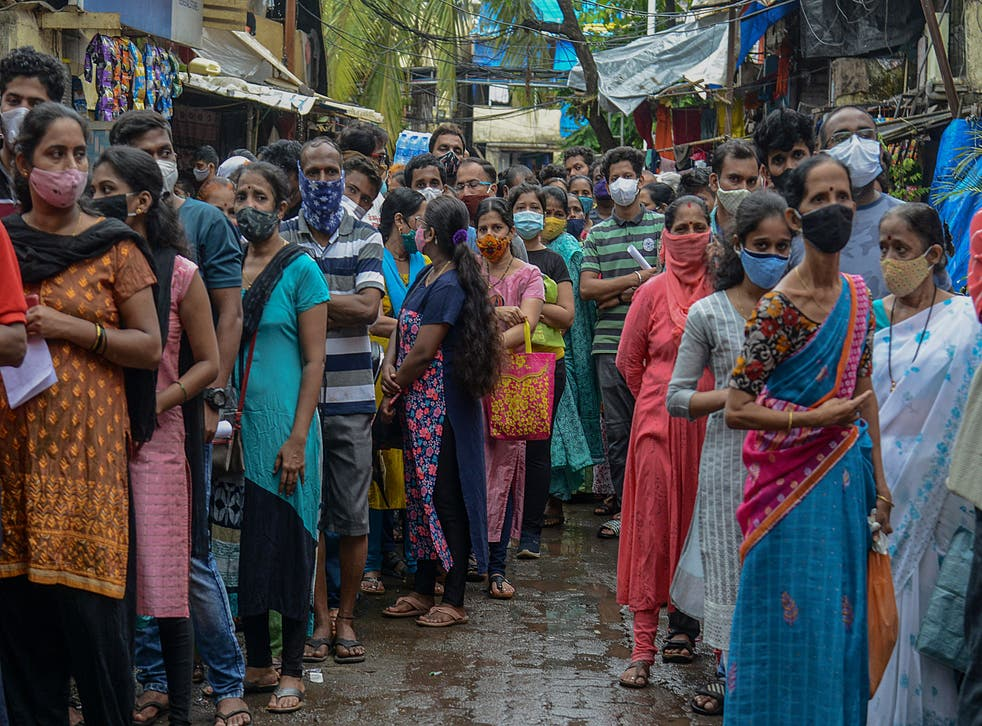 <p>People queue up to get themselves inoculated at a residential settlement in Mumbai on 2 August 2021</p>