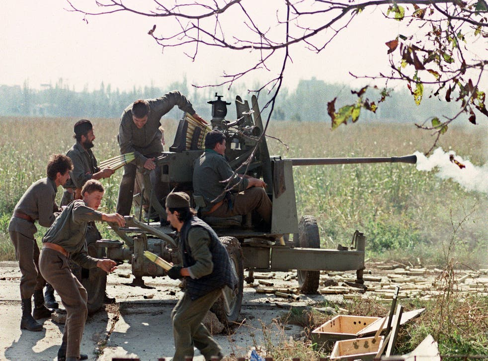 <p>Serb volunteers in Borovo Selo load a cannon on the front line during the fighting for Vukovar against the Croatian forces, 5 October 1991</p>