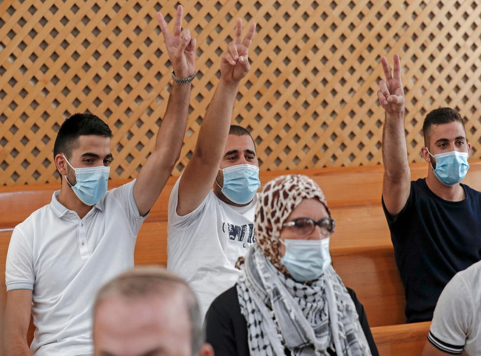 <p>Palestinian residents of the Sheikh Jarrah neighbourhood attend a hearing at Israel's supreme court in Jerusalem on August 2</p>