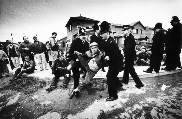 <p>A peaceful demonstrator being removed away from where Prime Minister Margaret Thatcher was due to arrive to visit the Eldonian Housing Estate in Liverpool during her tour of the North West in 1989 </p>