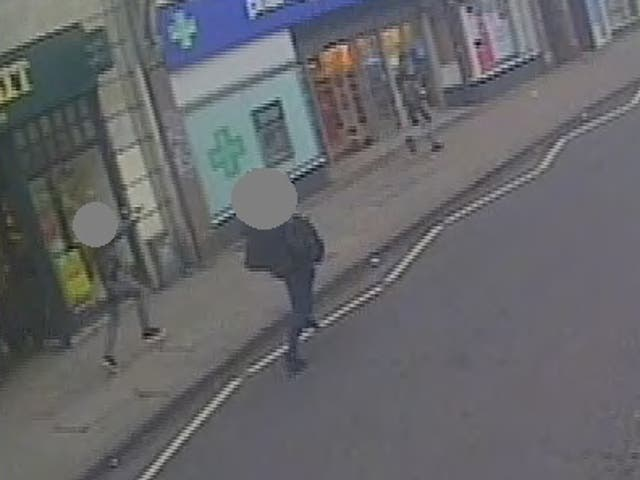 <p>A CCTV still showing undercover armed police officers chasing Amman, right, with their guns drawn after he stabbed two people in the Streatham attack</p>