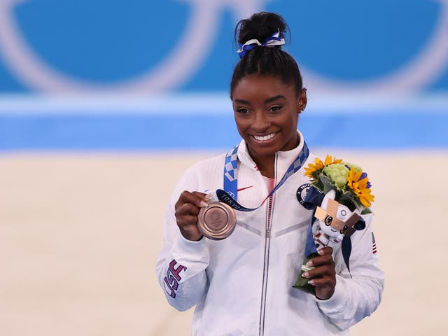 Simone Biles of Team United States poses with the bronze medal