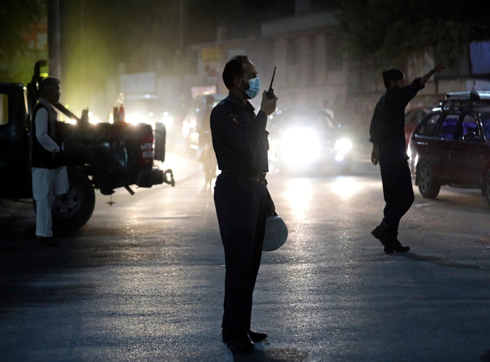 <p>Afghan security personnel work at the site of Tuesday's powerful explosion in Kabul</p>