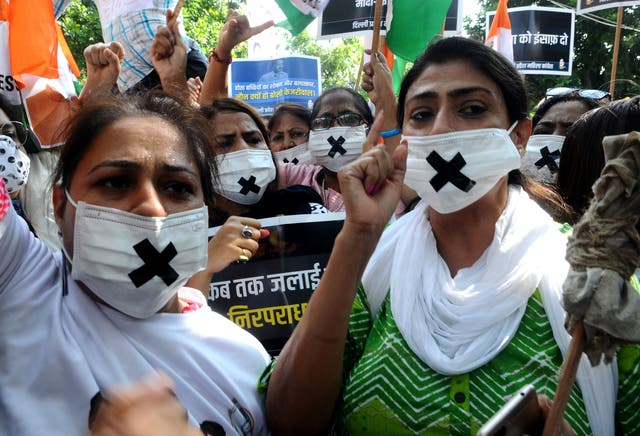 <p>Members of the Congress women's wing protest against the alleged rape, murder and forceful cremation of a nine-year-old girl in Delhi</p>