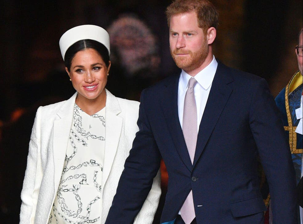 <p>Meghan Markle and Prince Harry walk hand-in-hand</p>