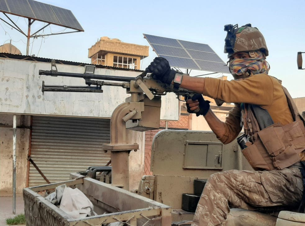 <p>Afghan forces patrol during fighting with Taliban fighters in Lashkar Gah</p>