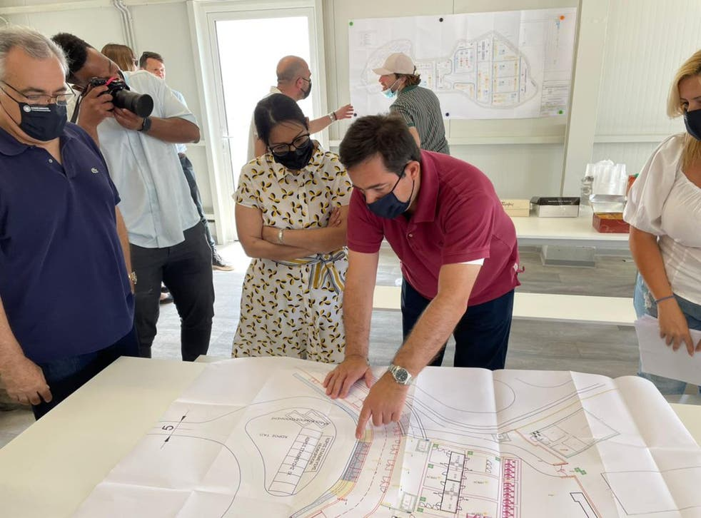 <p>The home secretary looks at plans for the new reception centre on Samos Island</p>