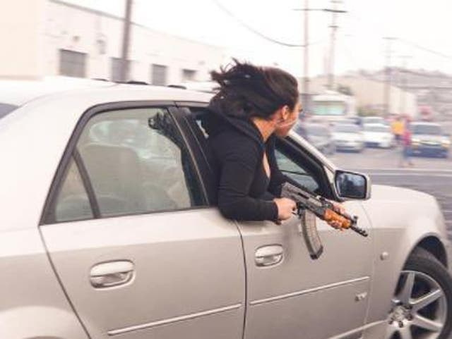 <p>Police revealed that a woman leaned out of a Cadi holding an AK47 in a statement on Thursday</p>