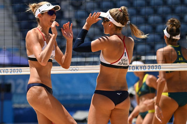 USA's Alix Klineman (L) gestures to partner April Ross in their women's beach volleyball final match between Australia and the USA during the Tokyo 2020 Olympic Games at Shiokaze Park in Tokyo on August 6, 2021