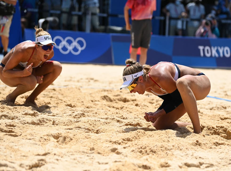 <p>USA's Alix Klineman (L) and April Ross celebrate winning their women's beach volleyball final match between Australia and the USA during the Tokyo 2020 Olympic Games at Shiokaze Park in Tokyo on August 6, 2021.</p>