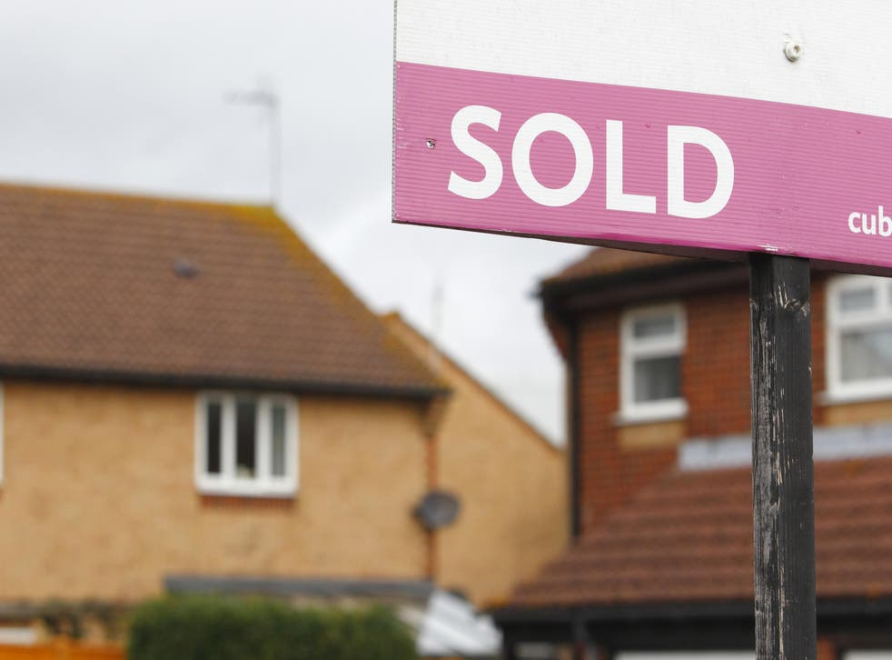 Annual house price growth cooled in July, the month that a stamp duty holiday started to be tapered, according to Halifax (Chris Ison/PA)